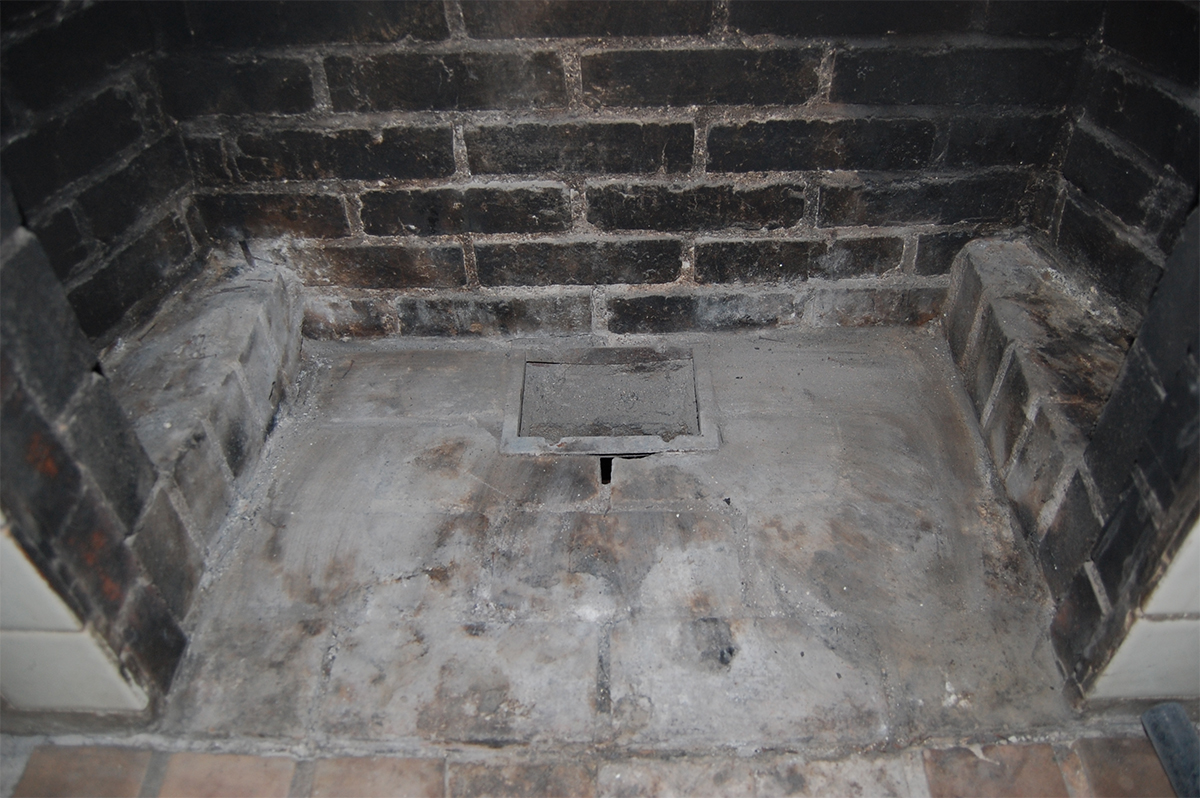 This is an opening that is located at the bottom of a fireplace. After ash has accumulated enough, you can then dump it from this opening, and into a container for means of disposal.